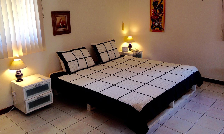 Slaapkamer 1 met airco - Vakantiehuis Aruba